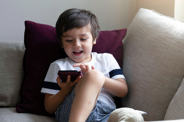 A Child is Playing on Mobile